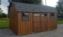 Wood stained siding, Estate Gray shingle roof, 12x16 highwall portable building in Cochranton