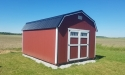 Highwall barn with Jamestown red wood siding and black metal roof