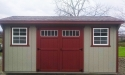 Saltbox shed with clay wood siding and jamestown red trim